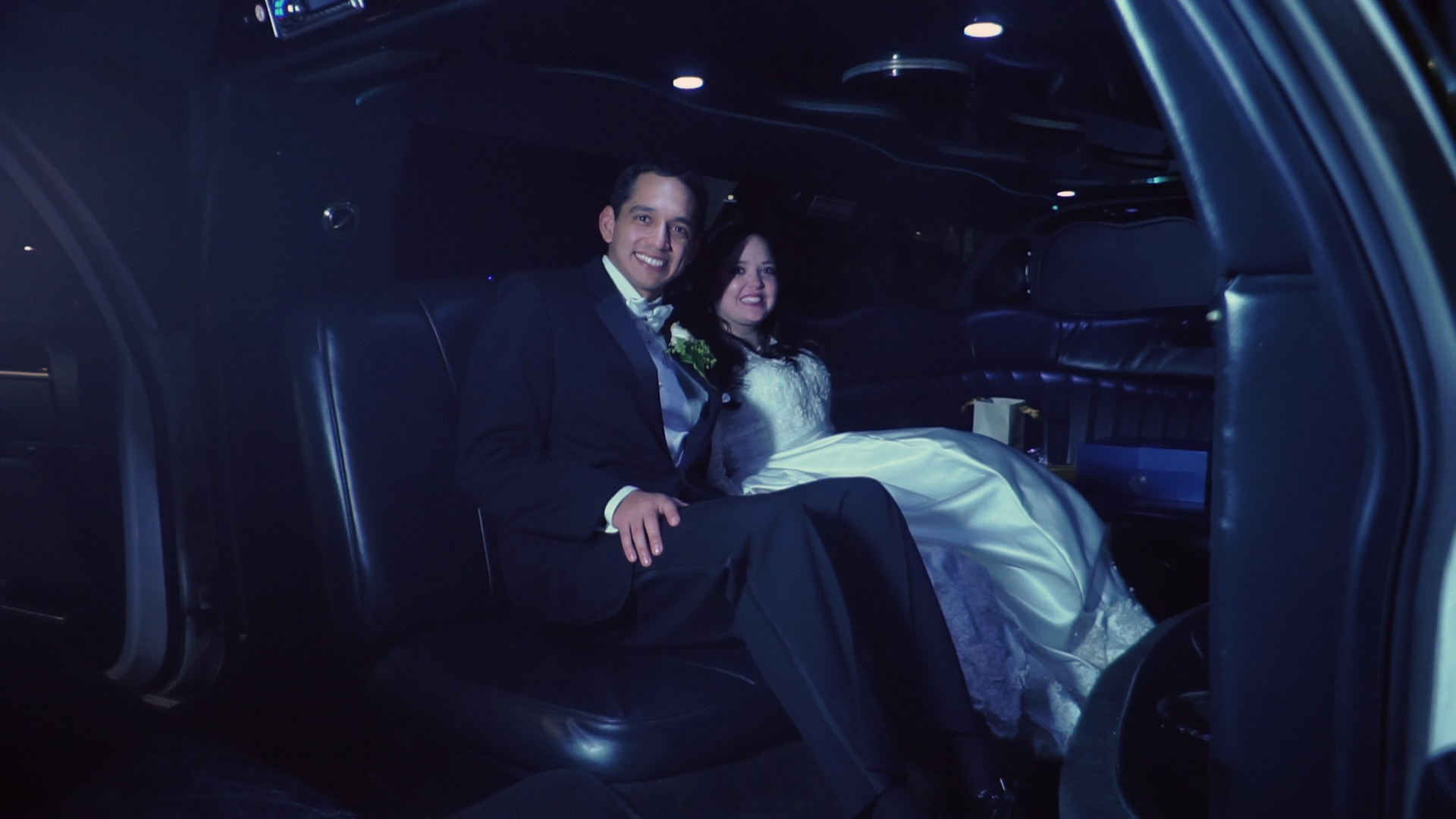 Bride and groom in a limo