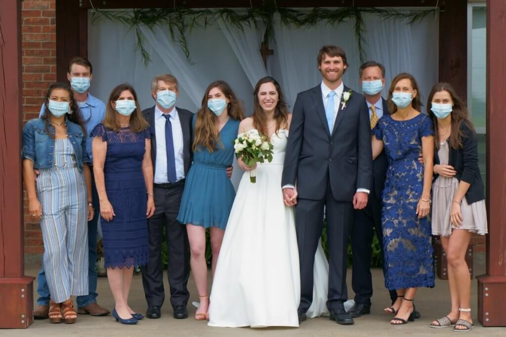 Mask up for a covid wedding photo